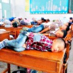chinese children taking nap on their desk